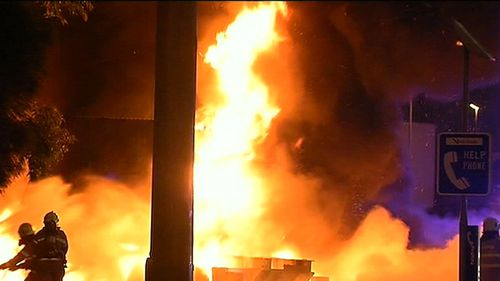 A passer-by managed to pull the driver from the truck's cabin before it caught fire. (9NEWS)