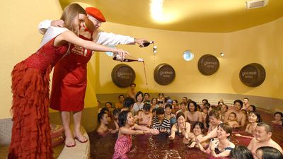 The Yunessan spa resort in Hakone, Kanagawa changes almost a 13,000 litre bath into their famous wine bath by adding nine liters of Beaujolais Nouveau per day. (AAP)