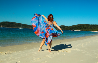 Woman in flowy dress on Whitehaven Beach