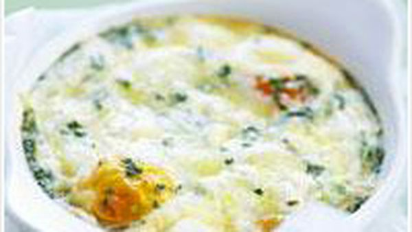 Baked eggs with herbs and fetta