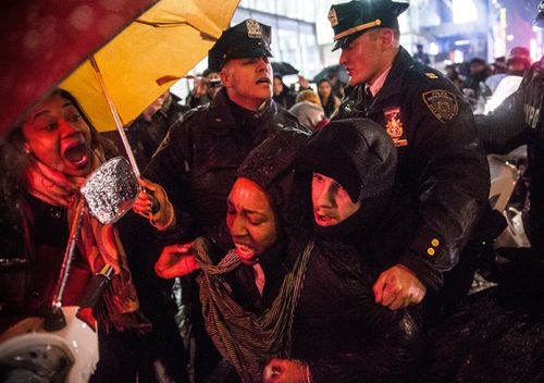 A woman is arrested in 2014 by police while protesting the Staten Island, New York grand jury's decision not to indict a police officer involved in the chokehold death of Eric Garner in New York City