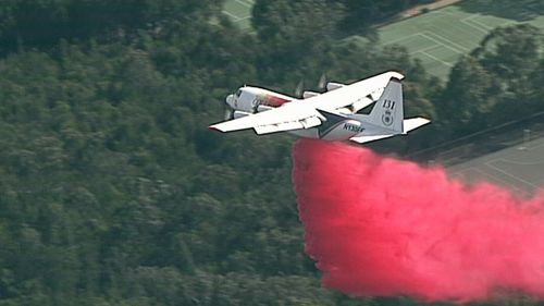 Flame retardant has been dropped on homes under threat with reports one is already alight near Canoon Road.