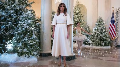 first lady melania trump watches a ballerinas perform a piece from the nutcracker among the 2017 holiday decorations in the grand foyer of the white house