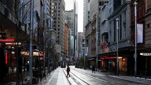 Sydney's normally bustling George Street lies empty during lockdown.