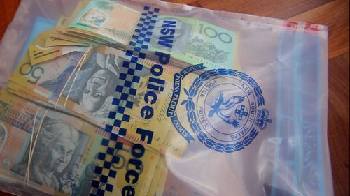More than $30,000 in cash has been seized as part of an investigation into drug trafficking.