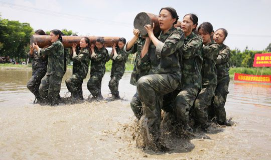 Chinese cabin crew students undergo military training