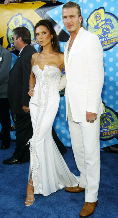 <p>White Out</p> <p>Posh and Becks look like they called up P.Diddy for some styling advice as they rocked  white, rhinestone encrusted outfits at the 2003 MTV Awards in Los Angeles.</p>