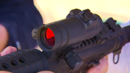 The AR-15s are lightweight, semi-automatic guns that use laser optics and are deadly accurate. (9NEWS)