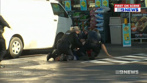 The man was tackled by police at the Thorngate service station. (9NEWS)