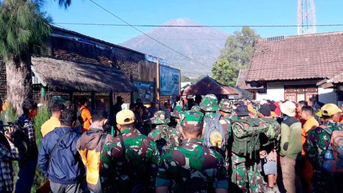 Indonesian soldiers and rescue team gather to prepare for evacuating tourists from Mount Rinjani. Picture: AAP