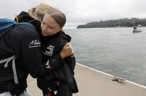 Climate activist Greta Thunberg gets a hug before she begins her voyage to the US from Plymouth on the Malizia II.
