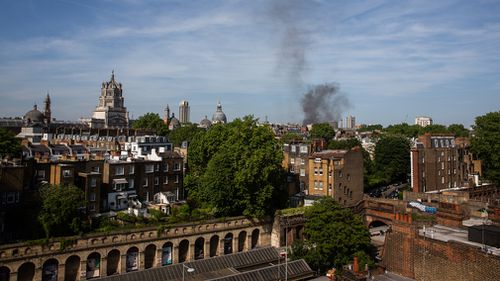 Thick plumes of smoke could be seen across central London. (AAP)