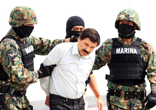 Mexican military hold Mexican drug lord Joaquin Guzman Loera, alias 'El Chapo' at the Navy hangar in Mexico City, Mexico in 2014.