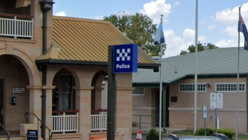 Queensland Police are today continuing to search for a man who attacked an officer and escaped custody yesterday after being escorted to the Warwick watch house.