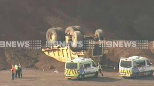 Man dies after dump truck tips over in Melbourne's north-west