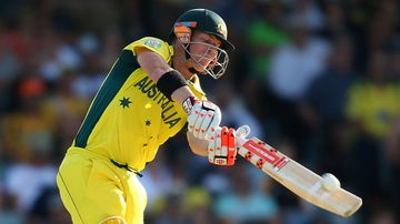 David Warner smashes a ball during Australia's World Cup match with Afghanistan. (Getty)