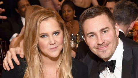 Amy Schumer and Ben Hanisch attend the 74th Annual Golden Globe Awards.