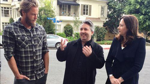 Australian actor Travis Fimmel, screenwriter Stuart Beattie and Queensland Premier Annastacia Palaszczuk in West Hollywood. (Image: AAP)