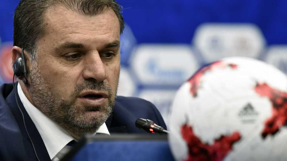 Socceroos coach Ange Postecoglou speaking after the draw for the Confederations Cup. (AFP)