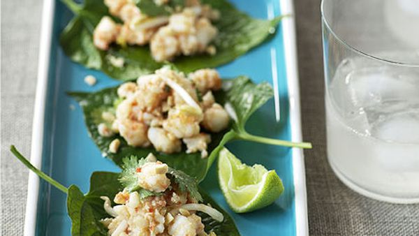 Betel leaves topped with prawns and galangal