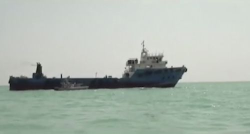 This undated image made from a video provided by the IRGC/IRIB shows a ship in the Persian Gulf. Iranian forces seized the ship, which it suspected of carrying smuggled fuel, state media reported Sunday, Aug. 4, 2019, marking the Revolutionary Guard's third seizure of a vessel in recent weeks and the latest show of strength by the paramilitary force amid a spike in regional tensions.
