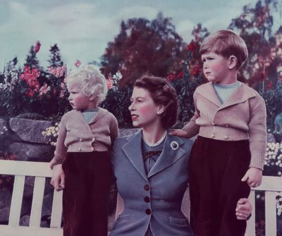Queen Elizabeth II with her children Charles and Anne at Balmoral, 1952.