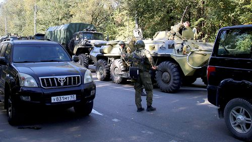 An army tank is seen at the scene of an attack on a school in Kerch in Crimea, Russia.