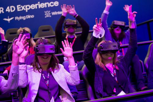 People try a VR gear during the Mobile World Congress. (AAP)