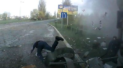 Customers at a gas station in Kiev, Ukraine have been filmed on dashcam miraculously surviving after they were launched by an explosion.