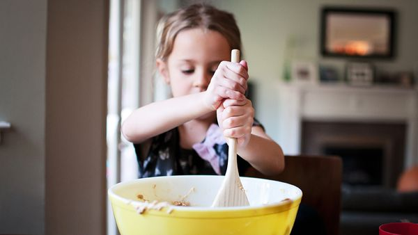 Mini chef: cooking a simple meal is an essential life skill for children before they hit high school. Image: Getty