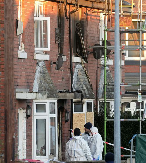 Forensic officers at the scene of the house fire on Jackson Street in Worsley, Greater Manchester.