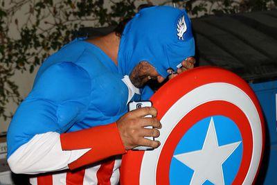 A plastic Captain America shield is the perfect paparazzi deterrent, right Gerard?