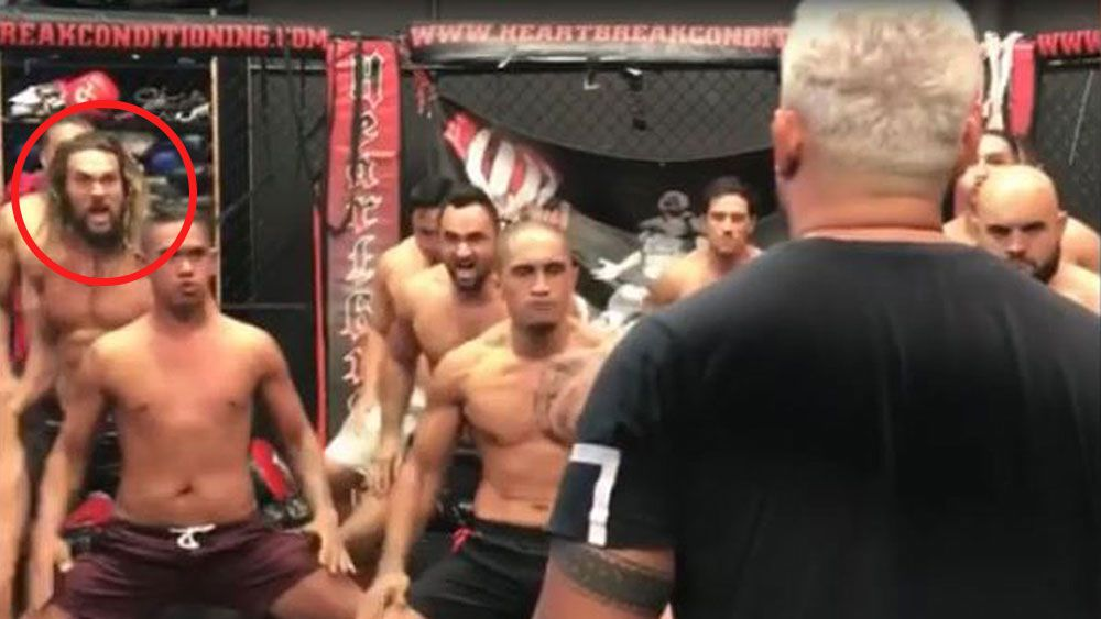 New Zealand UFC fighter Mark Hunt receives a haka from Aquaman's Jason Momoa