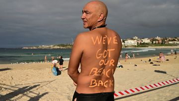 David Wesson poses for a photo as Bondi Beach reopens for exercise to the public after closing following an outbreak of coronavirus (Joel Carrett).