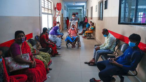 A patient infected with black fungus is taken on a wheelchair for treatment at the mucormycosis ward of a government hospital in Hyderabad, India