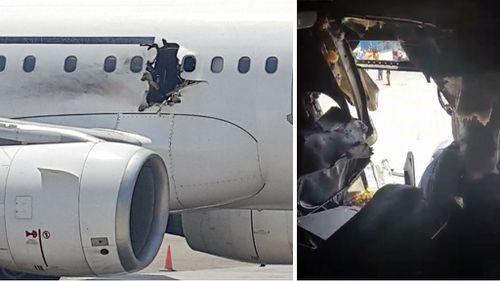 The metre-wide hole in the Daallo Airlines plane. (AFP)