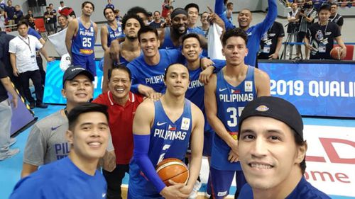 Philippines basketball team take a selfie during the game, after the fight erupted. Picture: Supplied